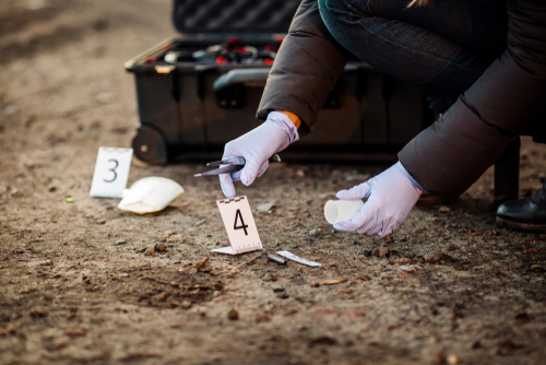Crime Scene Investigator collecting evidence