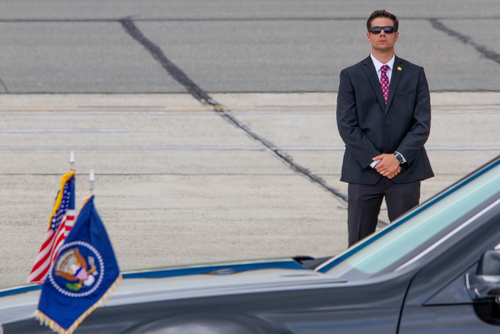 Secret Service Agent Standing by the Presidential State Car