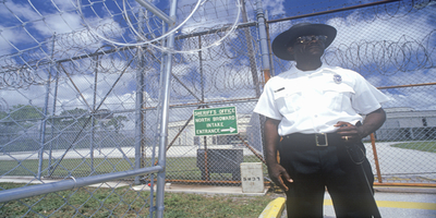Prison Guard Standing Outside of a Correctional Facility