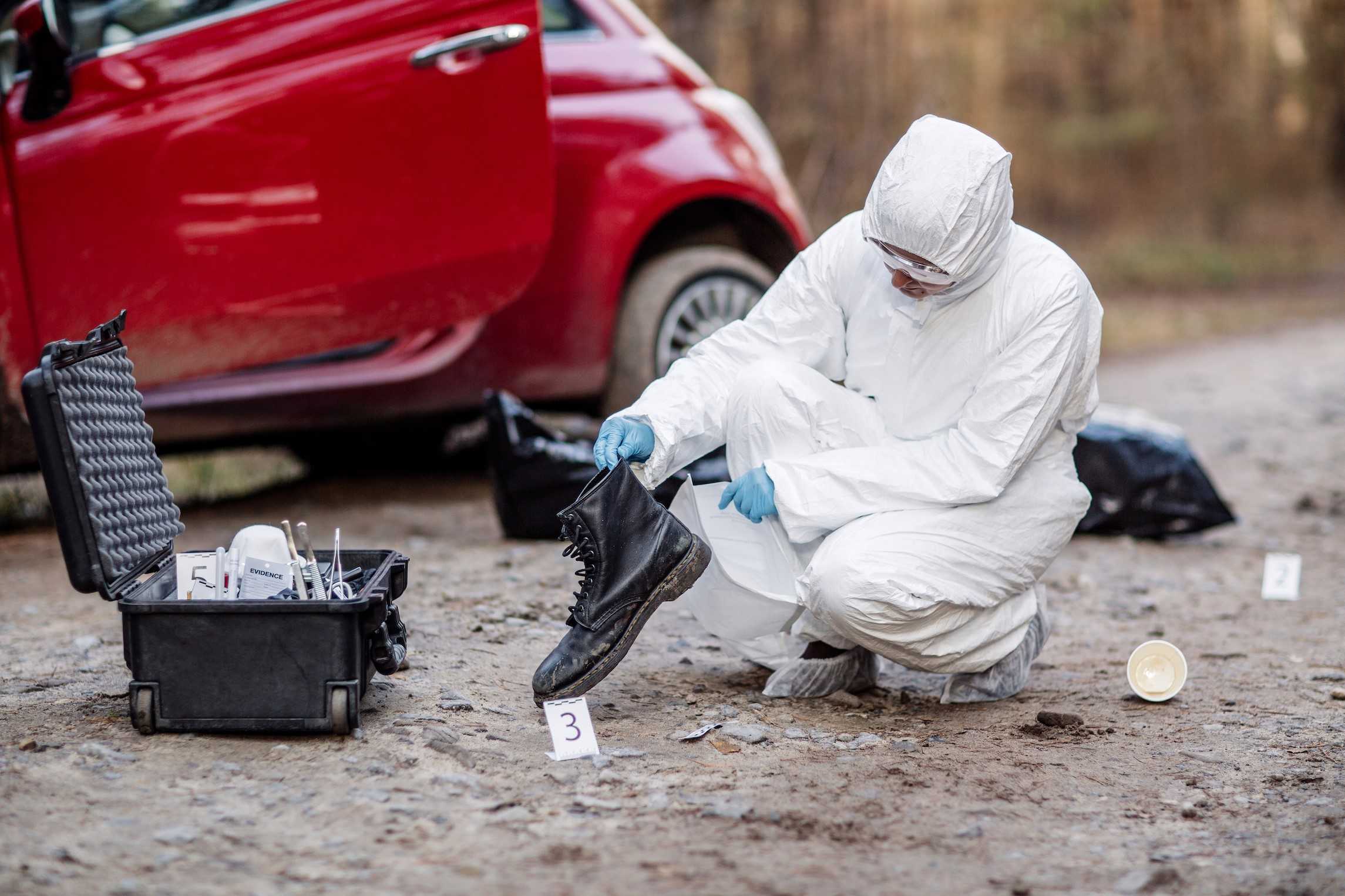 Forensic Technician Analyzing Evidence at a Crime Scene