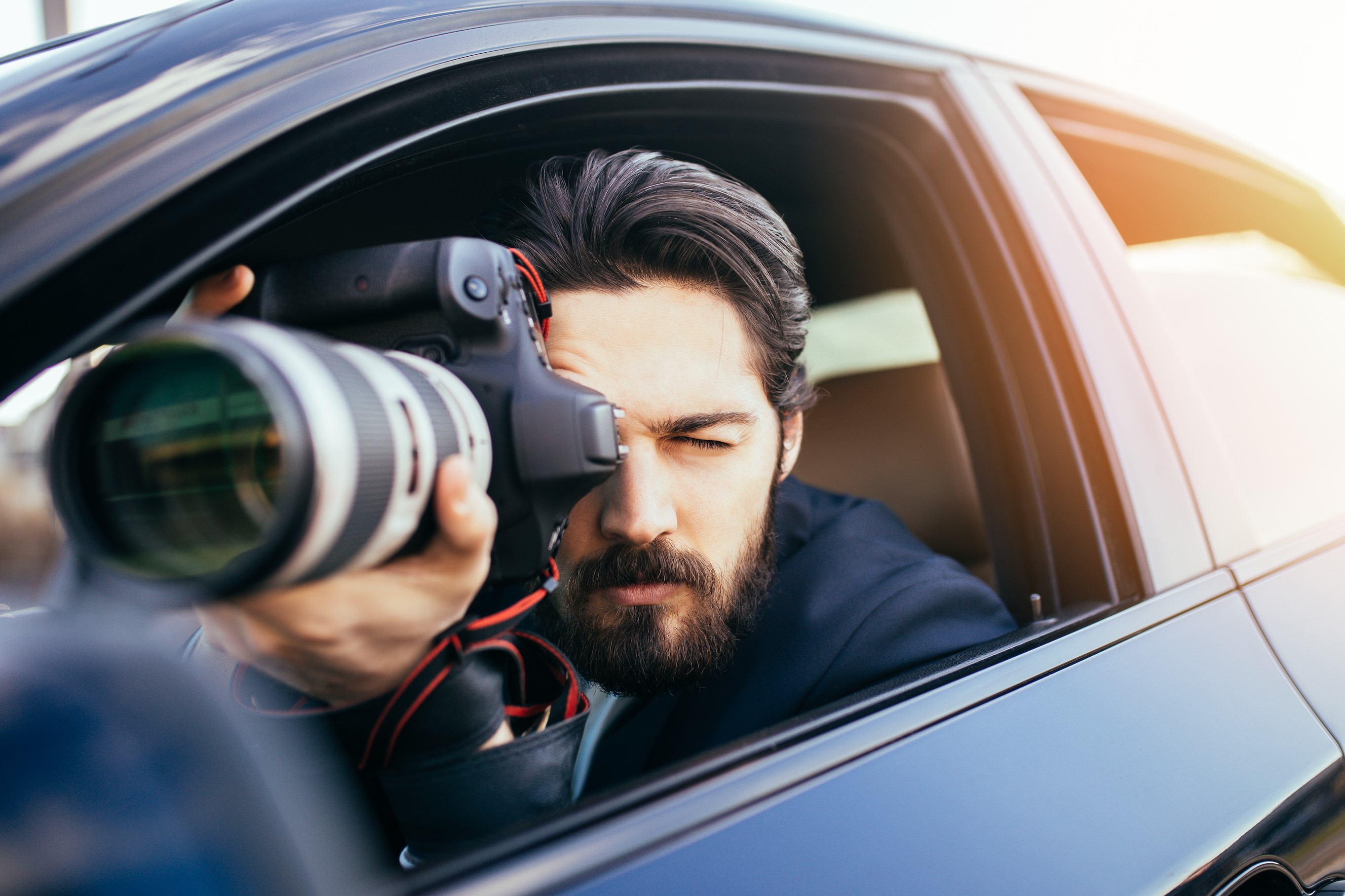 Private Investigator Capturing Photos from His Car