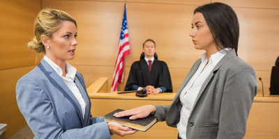court clerk swearing in witness in courtroom