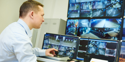 security officer managing video surveillance