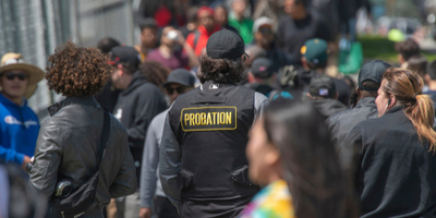 probation officer overseeing large crowd