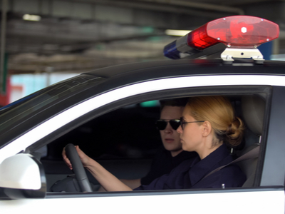 Two police officers driving in a car